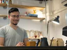 Man being barista and own a small coffee shop. royalty free stock photos