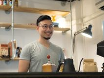 Man being barista and own a small coffee shop. stock photo