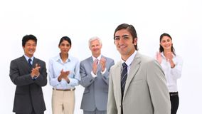 Man being congratulated by his coworkers Stock Photo