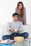 Man being distraction. From his studies by video games stock photos