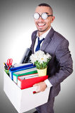 Man being fired with box Royalty Free Stock Image