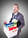 Man being fired with box of personal stuff Royalty Free Stock Photos