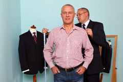 Man being fitted for a bespoke suit stock image