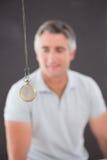 Man being hypnotized Royalty Free Stock Photo