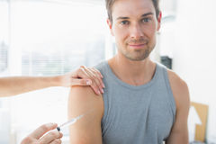 Man being injected by doctor Royalty Free Stock Photos