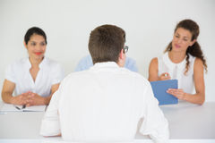Man being interviewed by business people Stock Image