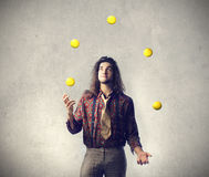 Man being a juggler Royalty Free Stock Images