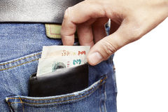 Man being pickpocketed stock photos
