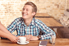 Man is being served in cafe Stock Photo