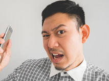 Man being shouted from smartphone. Stock Photos