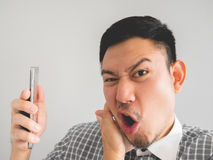 Man being shouted from smartphone. Royalty Free Stock Photography
