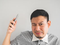 Man being shouted from smartphone. stock image