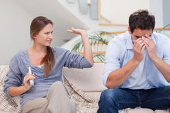 Man being tired of arguing with his wife stock photo