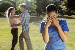Man being unfaithful in the park Stock Photo