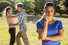 Man being unfaithful in the park Stock Photography