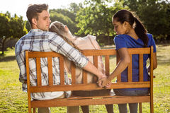 Man being unfaithful in the park Royalty Free Stock Photos