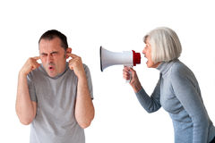 Man being yelled at by senior woman royalty free stock photos