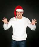 Man in the bell Santa's face shows terrible Royalty Free Stock Photography