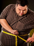 Man belly fat with tape measure weight loss around body. stock photography