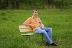 Man on bench Stock Photo
