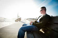 A Man on a Bench stock image
