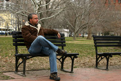Man on bench. Young man sitting on bench near White House stock photos