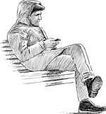 Man on a bench Stock Images
