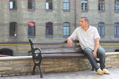 Man on the bench waiting Royalty Free Stock Photo