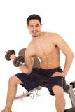 Man on bench with weight Stock Image