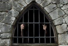 Man beneath bars Royalty Free Stock Photo