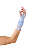 Man with Bent Elbow Wearing Wrist Brace in Studio. Close Up of Man with Bent Elbow Wearing Modern Supportive Orthopedic Wrist Brace Secured with Velcro Strap in royalty free stock photos