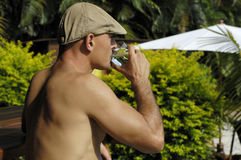 Man with beret. Man with french beret's drinking water Royalty Free Stock Image