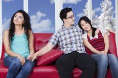 Man betraying his girlfriend Stock Image