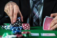Man betting on the casino. Poker chips royalty free stock photography
