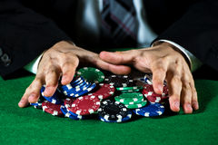 Man betting on the casino. Poker chips royalty free stock photos