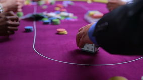 Man betting his house at poker stock footage