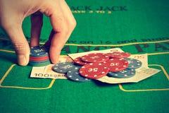 Man betting on poker. Royalty Free Stock Photo