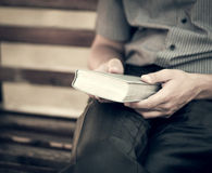 The man with the bible on the bench Royalty Free Stock Photo