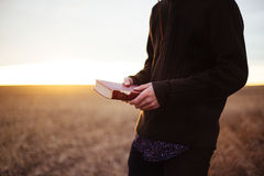 Man with Bible in field Royalty Free Stock Images
