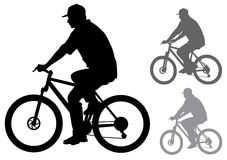 Man with a bicycle Stock Images