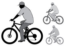 Man with a bicycle. The man in the cap riding a bike. Silhouette on a white background Stock Image