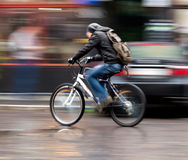 Man on bicycle  in the city Stock Photo