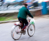 Man on bicycle in the city Stock Images