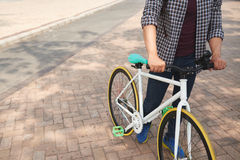 Man with bicycle. Cropped image of man standing next to his bicycle Royalty Free Stock Photos