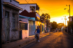 Man on bicycle in Cuban street. Camaguey, Cuba on January 2, 2016: Cuban man riding his bicycle through a street in the historic Caribbean city center of Royalty Free Stock Image