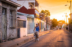 Man on bicycle in Cuban street. Camaguey, Cuba on January 2, 2016: Cuban man riding his bicycle through a street in the historic Caribbean city center of Royalty Free Stock Photography