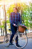 Man on bicycle with flowers basket is riding summer park . Stock Image