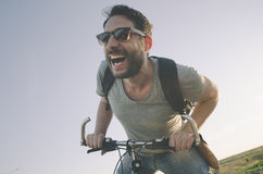 Man with bicycle Stock Photos