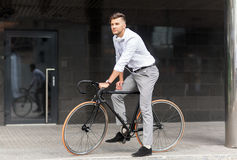 Man with bicycle and headphones on city street Stock Photos