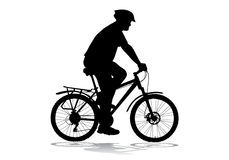 Man with a bicycle. A man in a helmet riding a bike ride Stock Photo